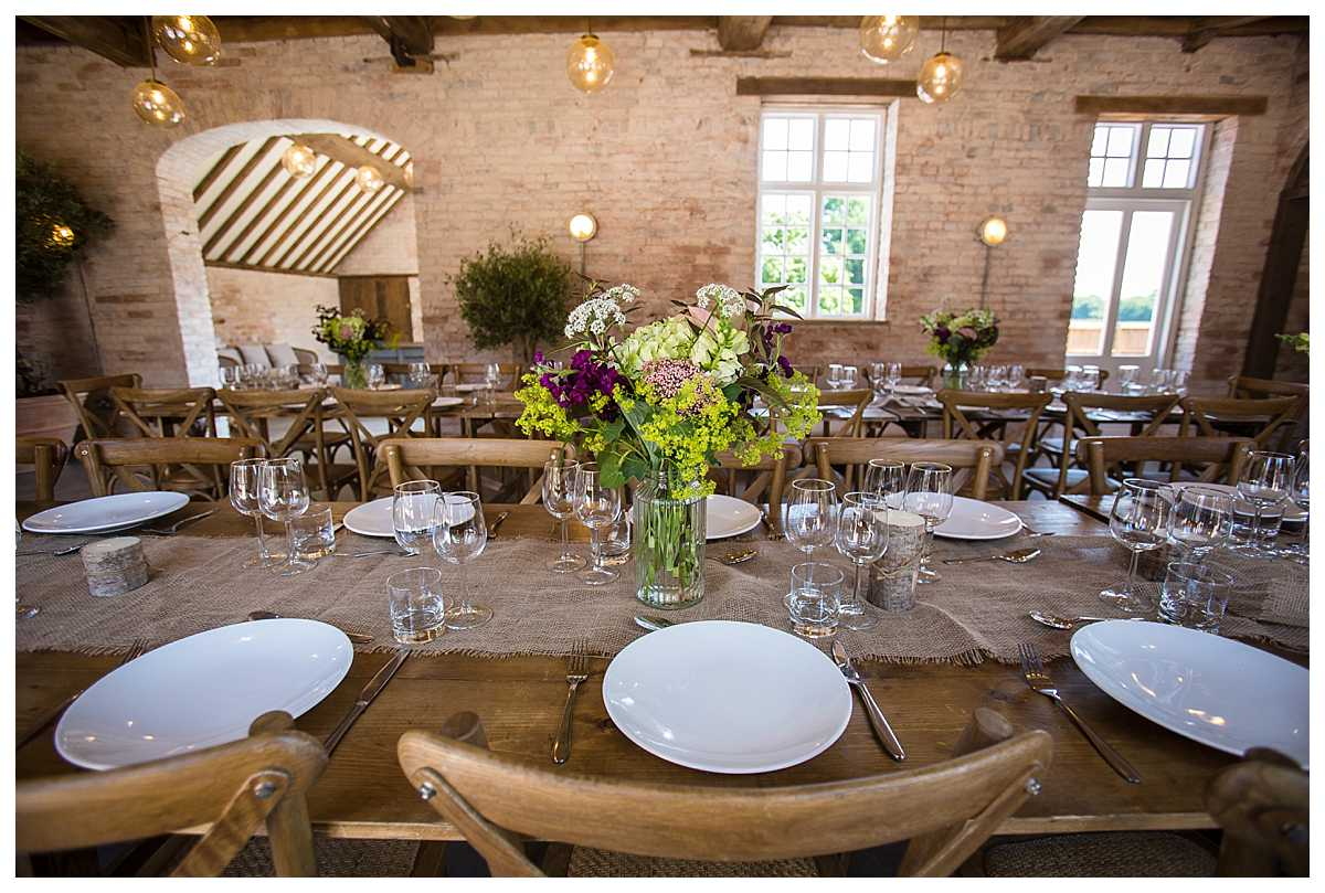 side view of the tables set up in long rows at the coach house the most recent addition to iscoyd park
