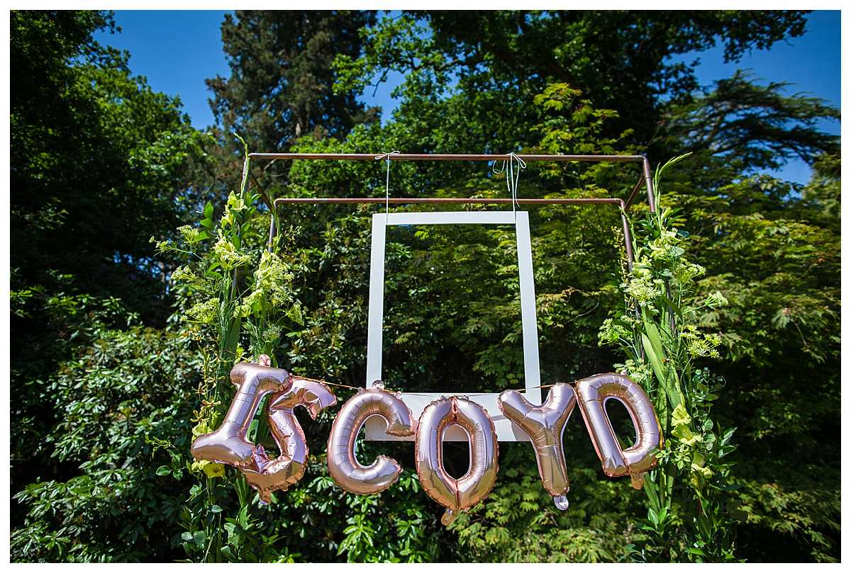 iscoyd balloons with a selfie wall in the gardens
