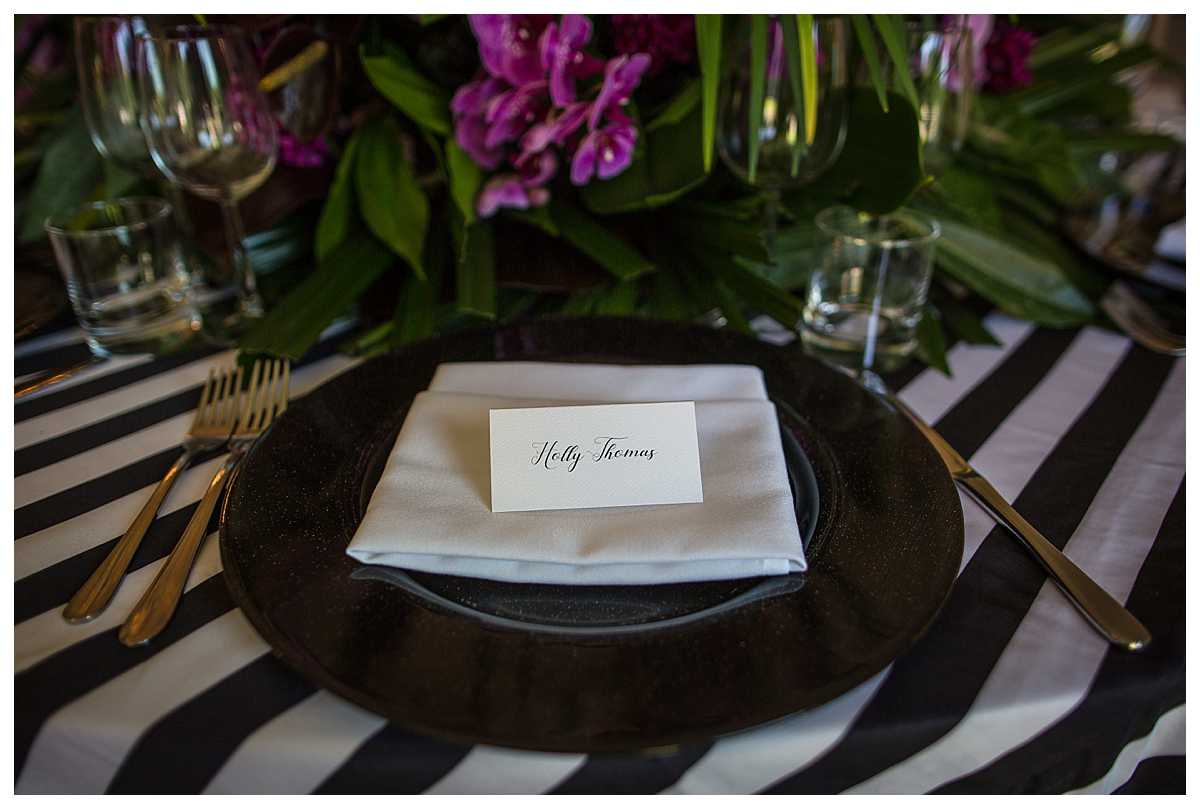 calligraphy hand written place settings on black and white themed table clothes