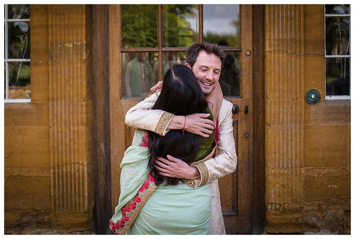 groom greeting mother in law to be at the front of poundon house wedding venue, bicester