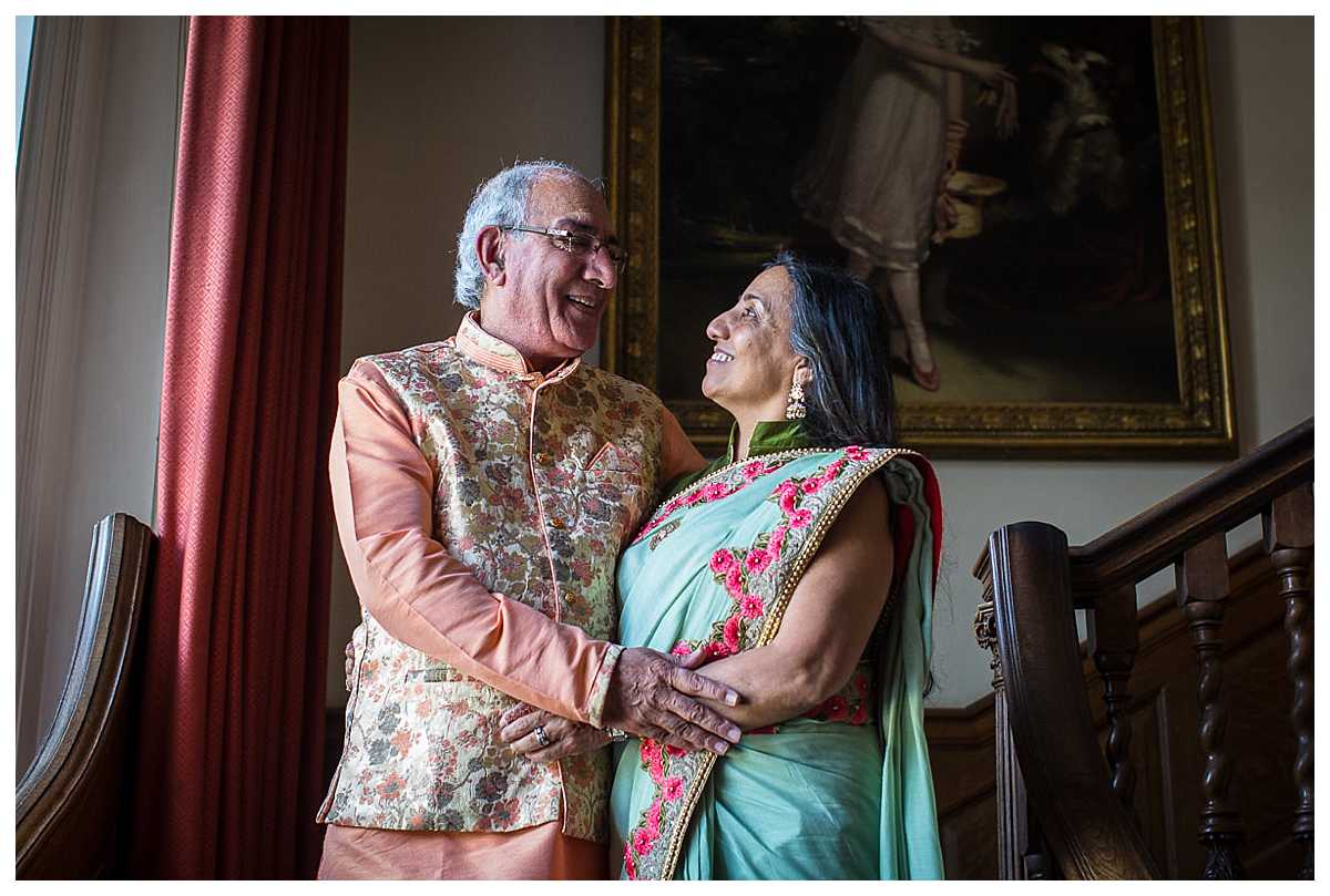 brides mum and dad in colourful indian dress in poundon house wedding venue