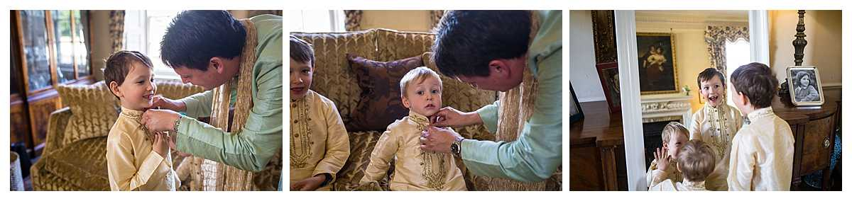 young pageboys getting jackets on and dad doing up buttons - charlotte giddings photography