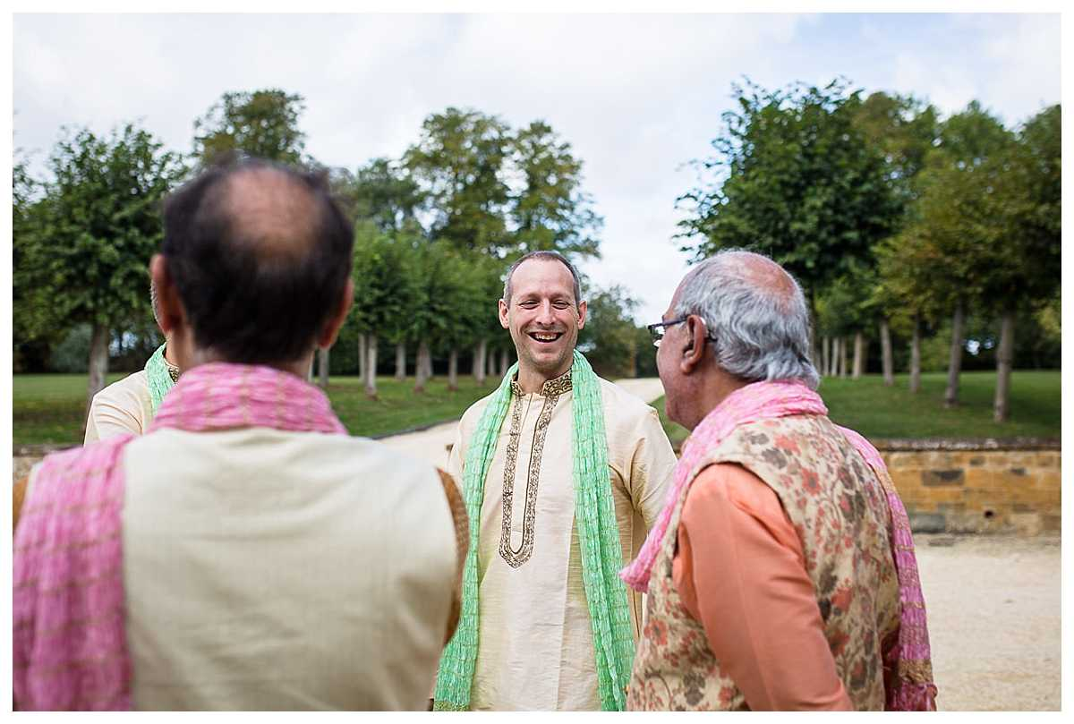 groomsmen laughing between themselves outside of poundon house, bicester