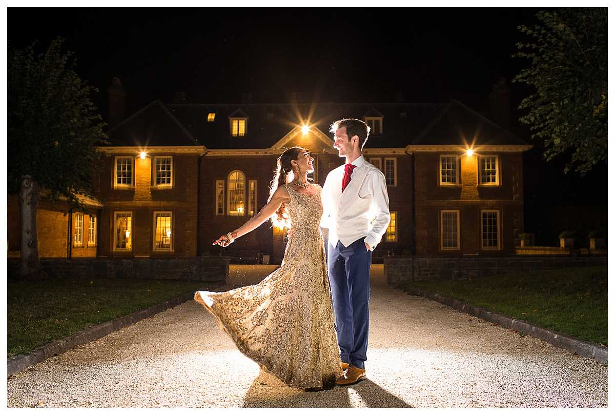 Indian wedding at Poundon House - bride and groom in traditional dress