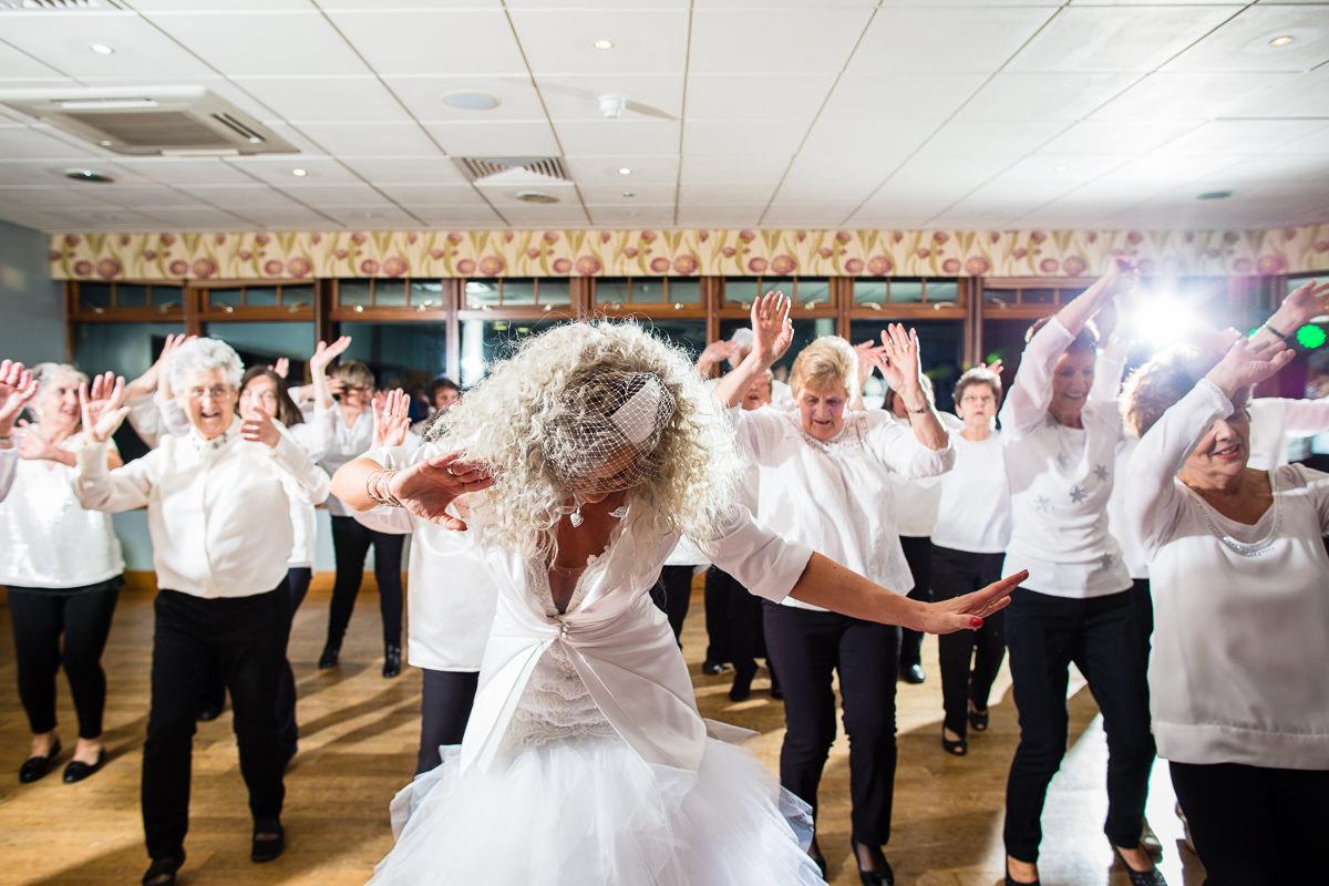 bride thoroughly enjoying herself waving arms around in the air dancing at wedding lake vyrnwy
