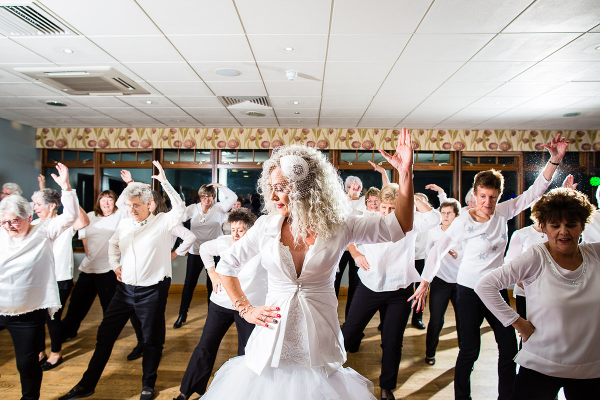 bride and dancing class performing a different dance move in synch