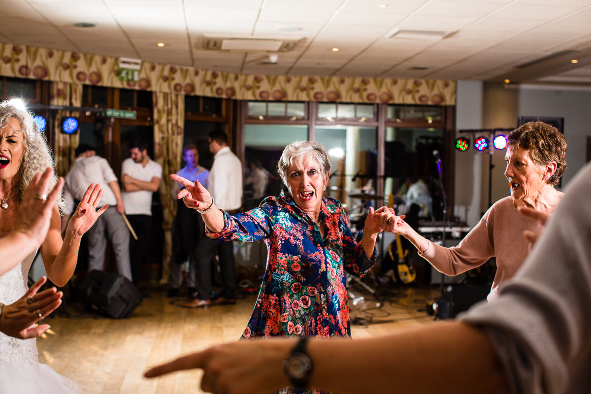 lady enjoying herself at the wedding party on the dance floor at lake vyrnwy hotel
