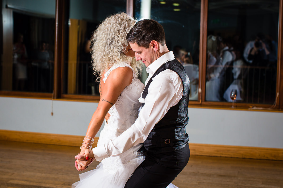 sexy dancing between bride and groom as they rock the dance floor at their lake vyrnwy wedding evening reception