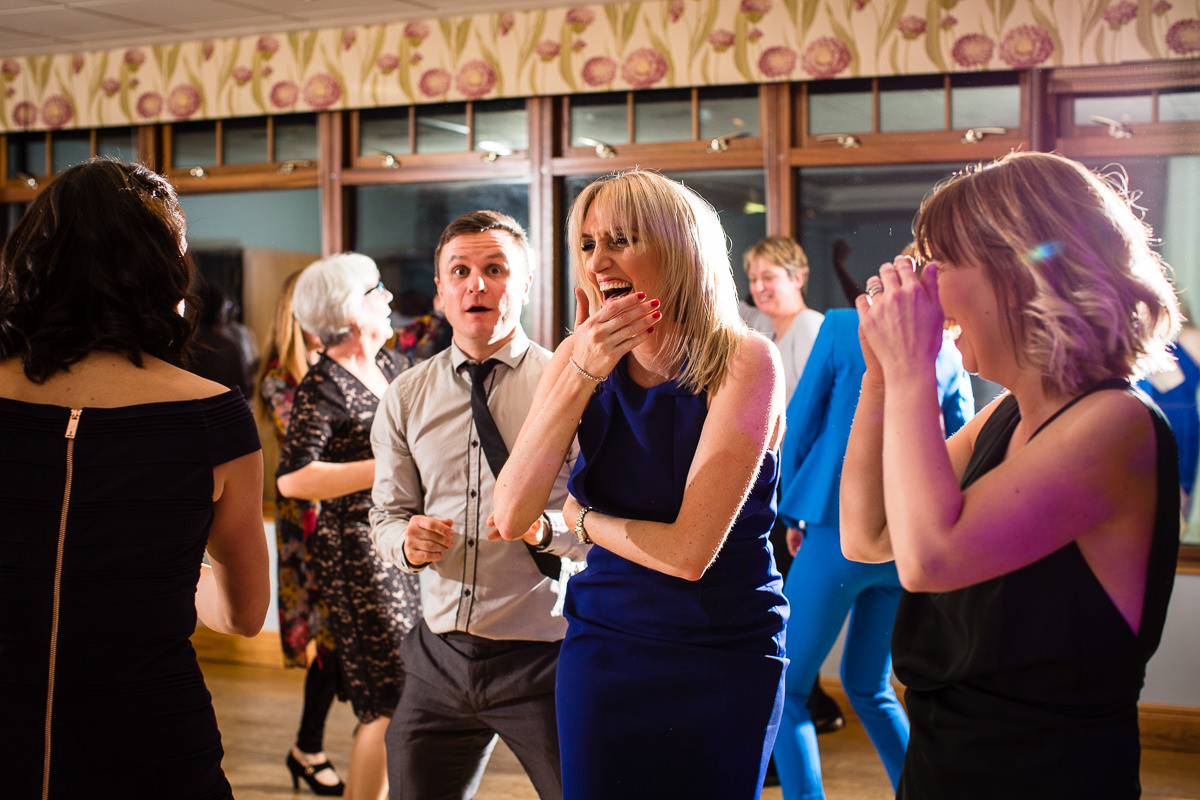 girls laughing on the dancefloor at lake vyrnwy hotel wedding evening reception do charlotte giddings photography