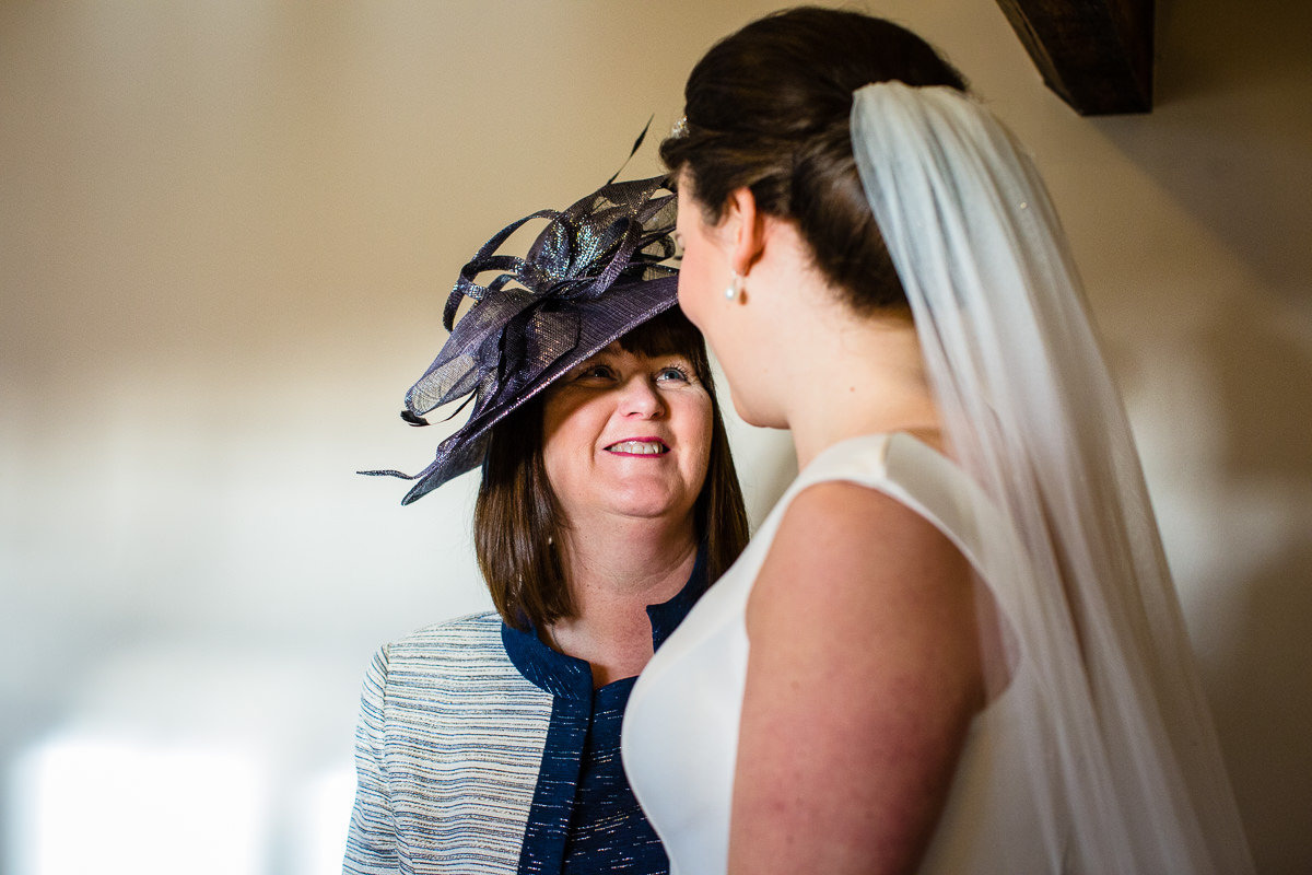 mother of the bride looking proud and happy at her daughter, charlotte giddings photography