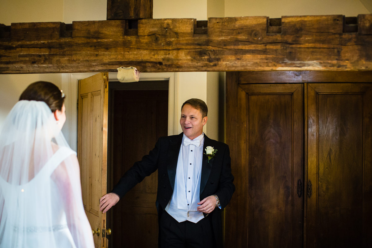 dads happy reaction as he sees his daughter ready to be bride