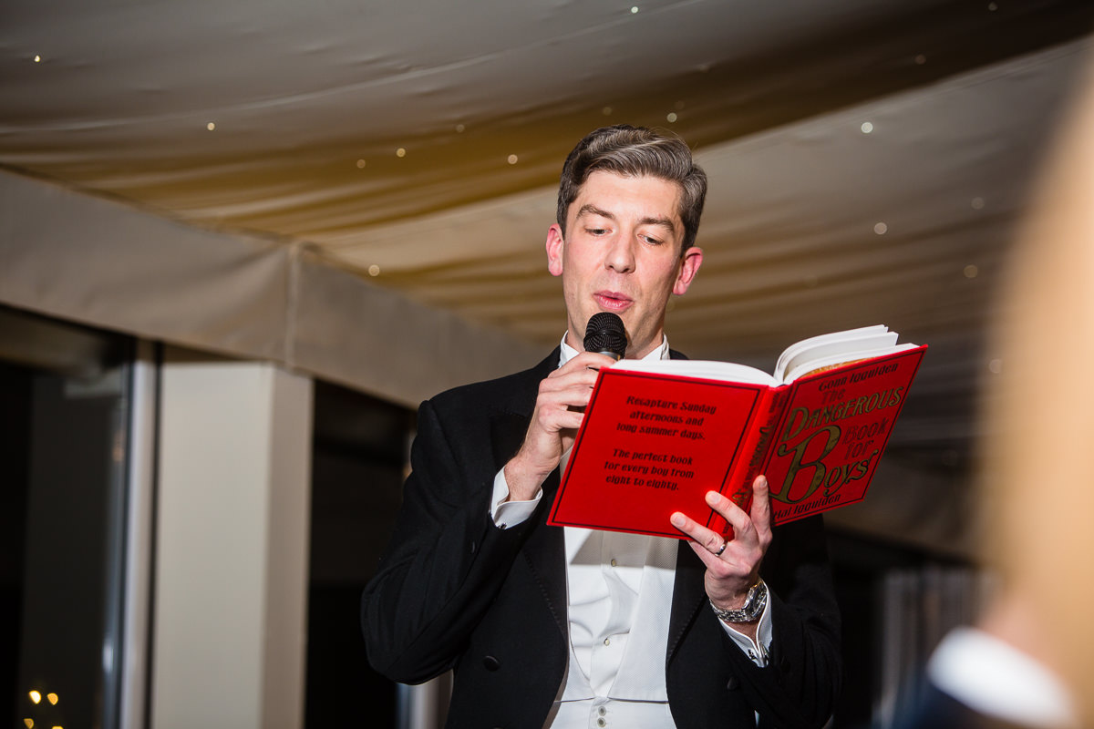 groom reading from the dangerous book of boys during his speech at the pavillion, combermere abbey