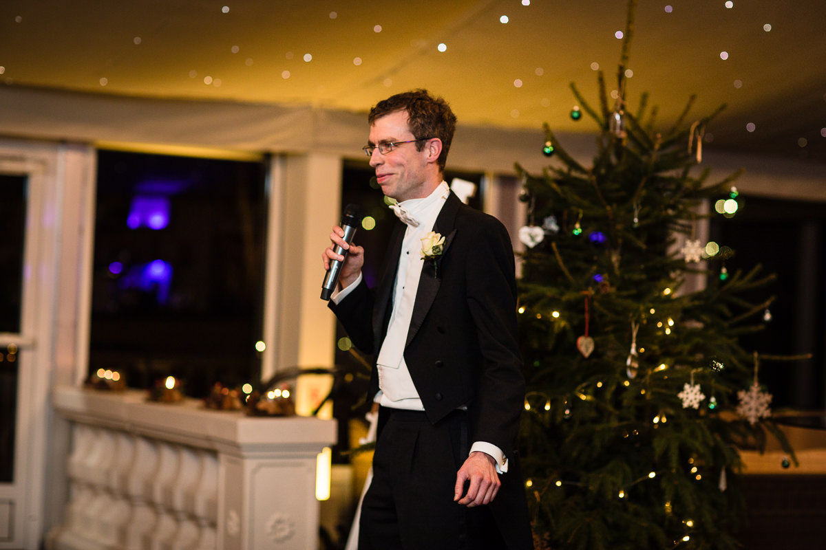best man doing him speech smiling as he tells tails about his brother, the pavillion, combermere abbey. charlotte giddings photography