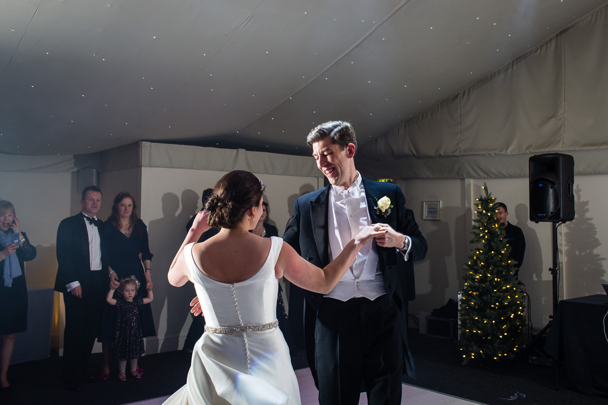 groom beaming with a huge smile as he and his wife do their first dance at combermere abbey, whitchurch, shropshire