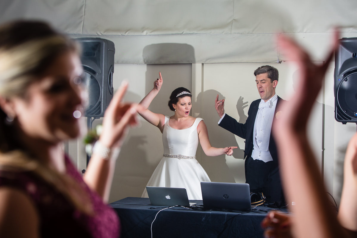 bride and groom dancing as they DJ the first set at their wedding at combermere abbey, shropshire wedding venue, charlotte giddings photography