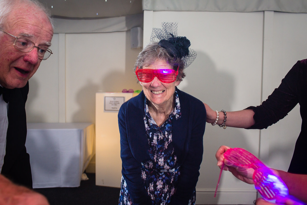 lovely grandma on the dance floor with glow on the dark glasses, the pavillion, combermere abbey