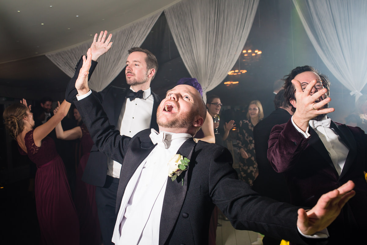groomsmen dancing to the greatest showman and really expressive, the pavillion combermere abbey, shropshire