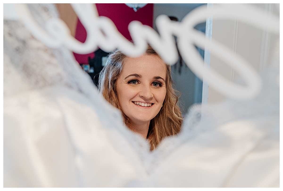 bride excited to put her wedding dress on, wedding photographer shropshire