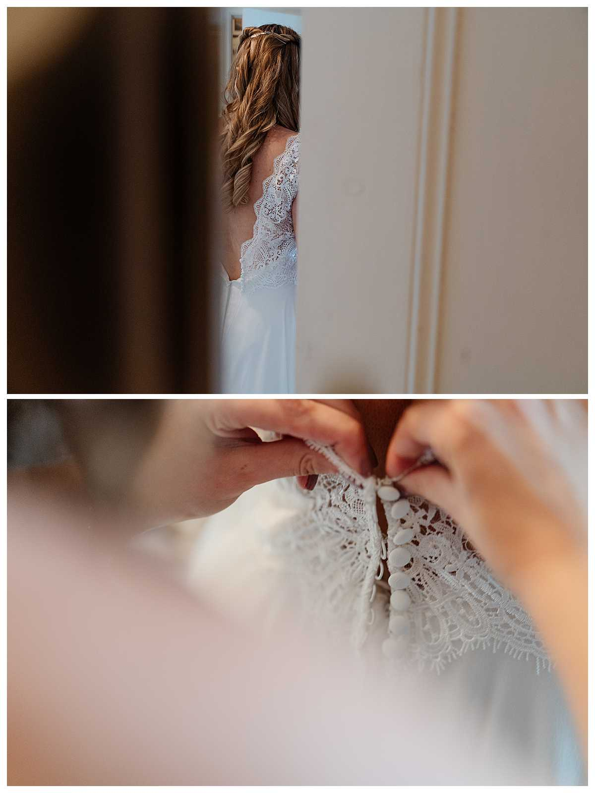 finishing touches, doing buttons up on wedding dress, charlotte giddings photography