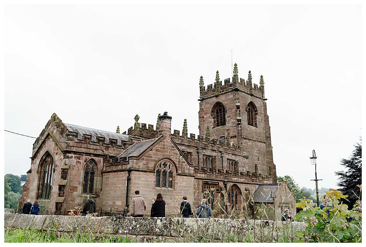 guests arriving at marbury church whitchurch shropshire on over cast day, shropshire wedding photography