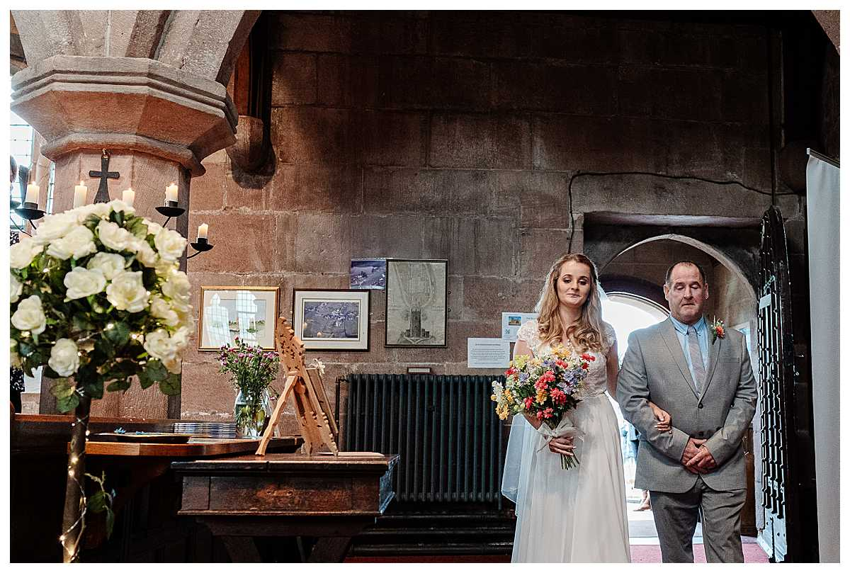 bride walking into marbury church, shropshire with her dad, charlotte giddings photography