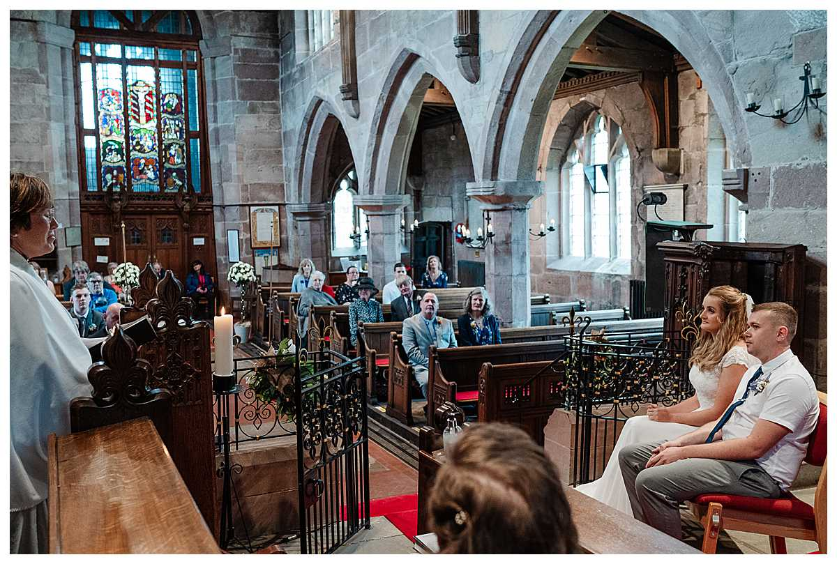 reverend talking to congregation at marbury church, shropshire - shropshire wedding photography