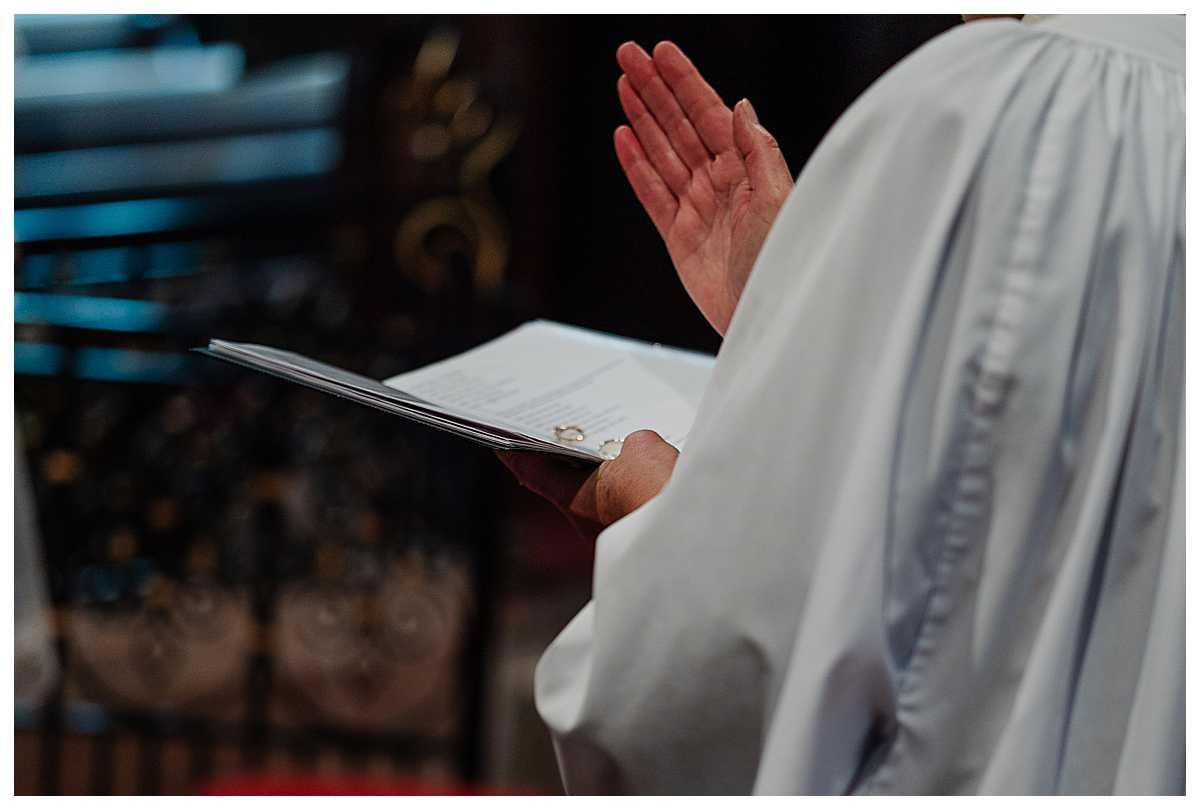 vicar blessing the wedding rings at marbury church shropshire - charlotte giddings photographer