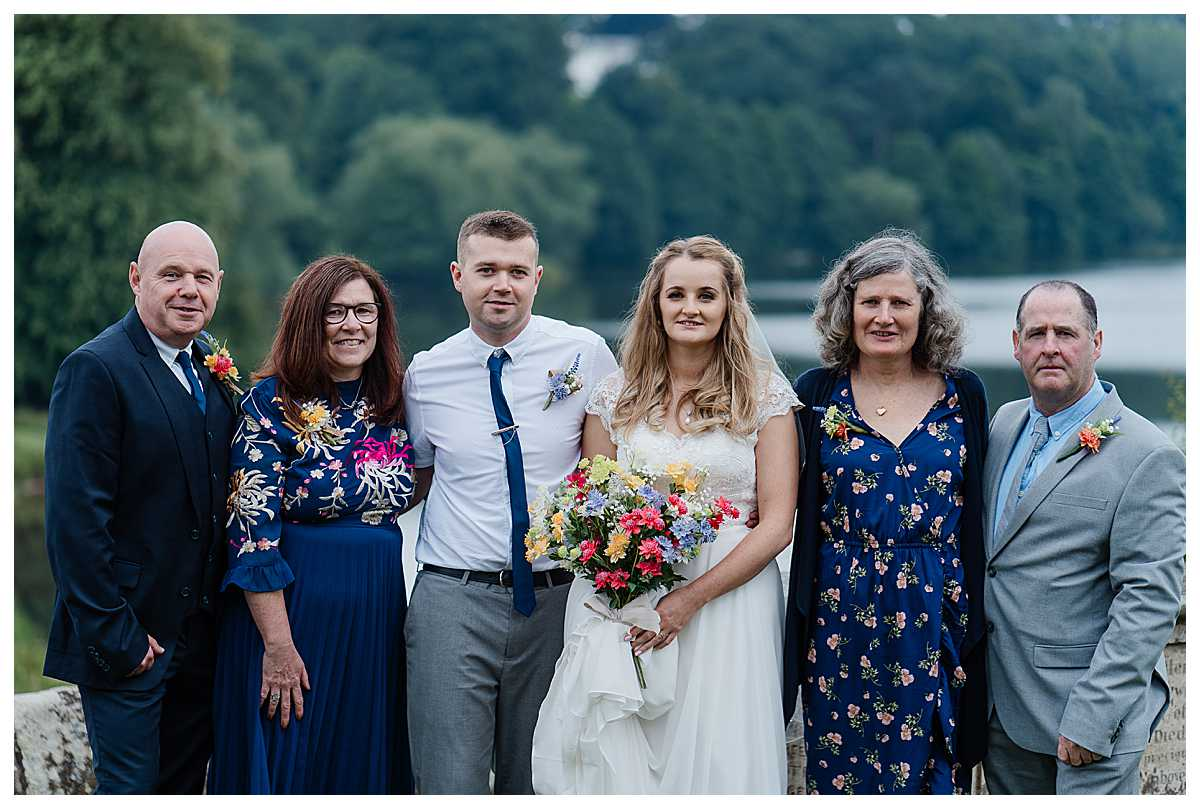 bride and groom with parents at marbury church wedding, shropshire