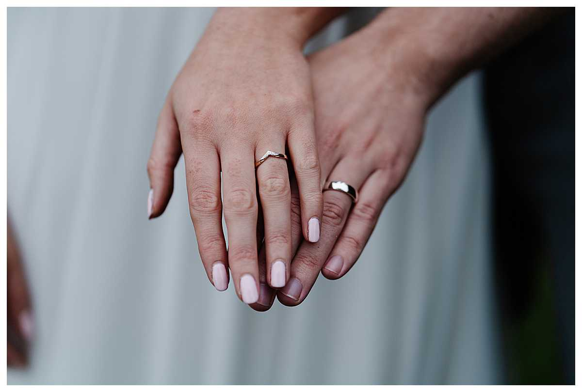 bride and grooms hands wearing wedding bands - shropshire wedding photographer