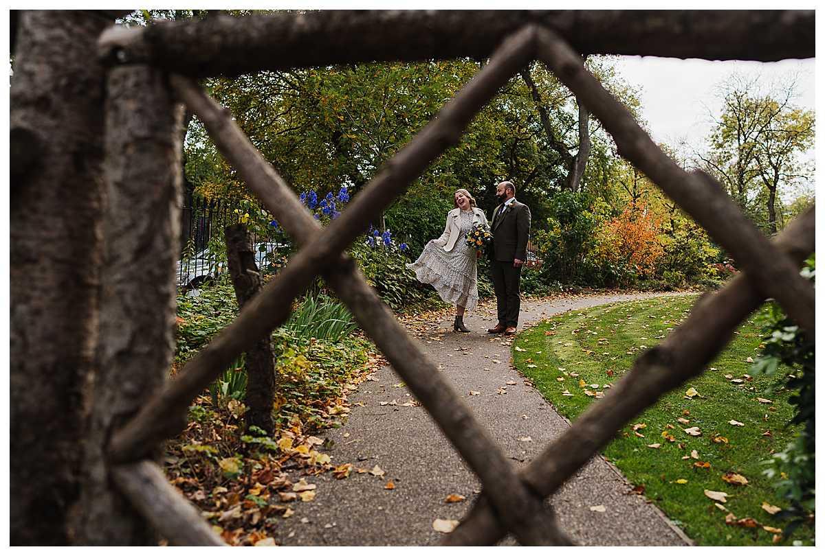 bride goofing around in the grounds of elizabeth gaskells house - north west wedding venue