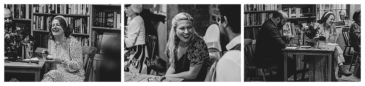 candid happy photos of the bride and guests laughing at elizabeth gaskells house, manchester