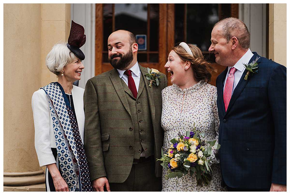 bride and groom laughing with brides parents at manchester wedding venue, charlotte giddings photography