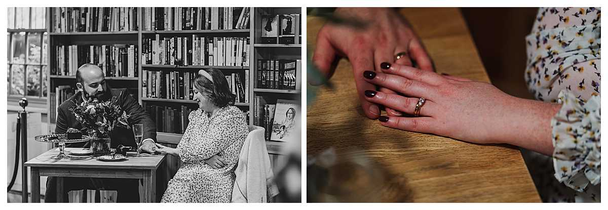 bride and groom looking at one anothers rings sat at the table/ charlotte giddings photography
