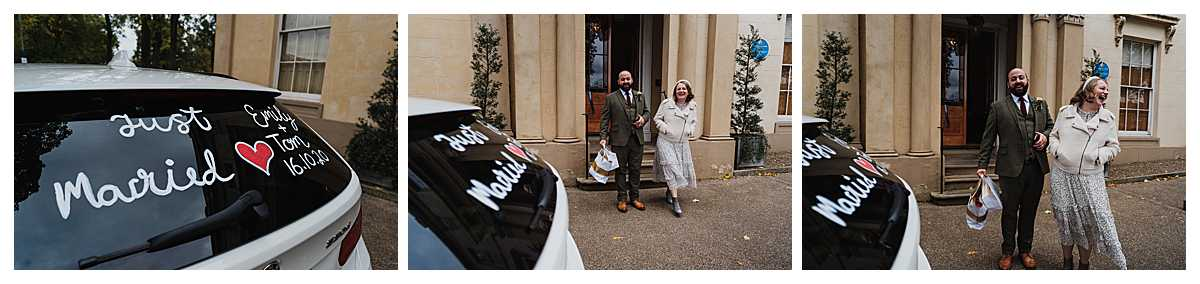 bride and groom seeing their wedding car with 'just married' written on it giggling outside their wedding venue manchester as a surprise