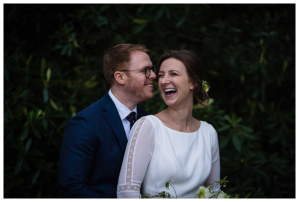 bride and groom giggling between themselves at cholmondley castle and gardens, charlotte giddings photography